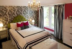 Hot pink green black teen girl's bedroom design with white & black damask wallpaper accent wall, green tufted microfiber headboard, hot pink magenta pillows, white leather tufted storage bench, flokati rug, mirrored nightstands, white & black striped silk drapes and magenta walls paint color.