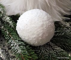 Paint styrofoam balls with mod podge, roll in epsom salts, then stack 3 of different sizes to make a snowman
