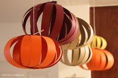 Hanging pumpkins! Cut strips of paper, staple at the ends to make sphere, and hang from ceiling.