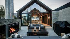 Indoor outdoor flow, floor to ceiling glass, concrete, steel and wood, simple design, minimalistic guttering, outdoor fire