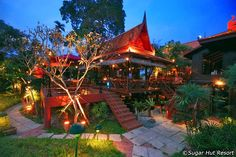 The Sugar Hut Restaurant, off Jomtien's Thappraya Road, is the hotel eatery for the Sugar Hut Resort, but is open to anyone looking for a traditional Thai meal in pleasant surroundings. Thai Restaurant, Winding Road, Pattaya, Swimming Pools, Entrance, Pergola, Tours, Outdoor Structures, Patio