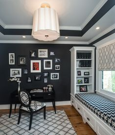 I chose this image because of the use of contrasting black and white colors which creates interest. I like playing with a wide selection of patterns having the contrasting colors black and white. I like combining black and white furniture as well as using the wall paint to compliment to the contrast. The red photo on the black wall create more interest and keeps the room away from being boring.