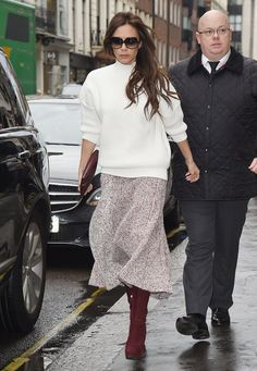 Victoria Beckham stayed dry in London on Friday.