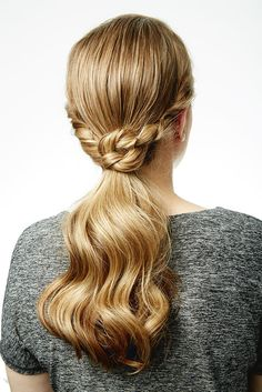 There are so many ways to dress up your pony and make it look elegant that go way beyond just concealing the hair-tie with strands. We wanted something fresh to work the 2015 party circuit, so we are introducing the knotted ponytail. This looped look by T3 celebrity stylist David Lopez has enough detail to make it fancy, but it's still easy to master at home. The simple technique elevates the boring low pony to formal holiday party status. Find out how you can achieve the look in just 3 step...