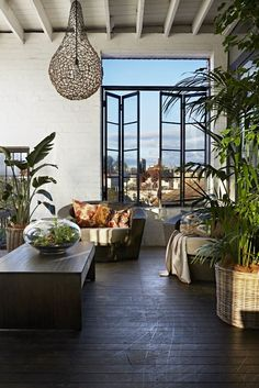 Indoors outdoors terrace of Melbourne warehouse apartment featured in Inside Out magazine. Styled by Jacqui Moore of Greenhouse Interiors and photographed by Armelle Habib.