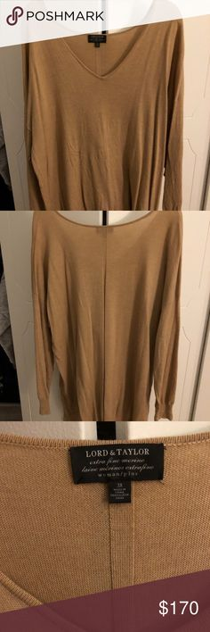 Lord and Taylor cashmere sweater Professional, tunic-like sweater. I've worn it to work one or two times during the winter season and it kept me super toasty. No visible stains or tears, it's in like-new condition. Lord & Taylor Sweaters V-Necks