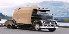 1954 Chevrolet COE truck... the trailer is a throwback to the Bowlus Road Chief RVs from the 1930s.