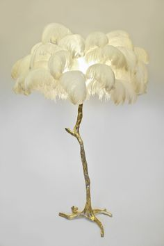 The Feather Lamp, Edition piece by A Modern Grand Tour An illuminating palm tree, resplendent with exquisite ostrich feather foliage, the Feather Lamp takes cen