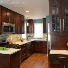 Blue Gray Kitchen With Dark Cabinets In Estuary At Grey Oaks