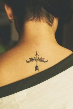 dainty arrow behind neck tattoo