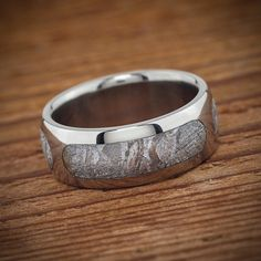 Meteorite wedding ring by Spexton that features 3 dashed segments of Gibeon meteorite inlaid into a titanium base. Unusual and Unique for a men\'s wedding band. Pagan Wedding, Wedding Men, Wedding Bands, Summer Wedding, Wedding Ideas, British Wedding, American Wedding, Ring Watch, Wedding Honeymoons