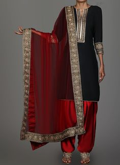 Black and Red Embroidered Punjabi Suit features a taffeta silk kameez with santoon inner alongside a santoon bottom and net dupatta. Embroidery work is completed with zari, sequins, stone and lace embellishments. Black And Red Suit, Red Black Dress, Pakistani Dresses, Indian Dresses, Indian Outfits, Indian Sarees, Designer Party Wear Dresses, Kurti Designs Party Wear, Choli Dress