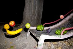 High contrast photos of fruit floating threateningly in the night