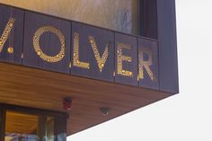 Detail of the John W. Olver Transit Center perforated facade signage.