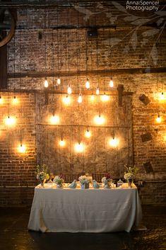 Anna and Spencer Photography, Atlanta Wedding Photographers. Wedding Reception: Bride and groom's sweetheart table with Edison bulb decor. F & G Weddings.