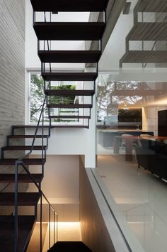 Industrial stairwell timber and steel stairs brick wall and amazing window and glass wall!
