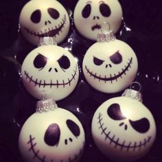 Take your clear glass ball add a little white paint inside, shake and swirl until it's fully coated, turn upside down on paper towels to catch any drips and let it dry. Use a black permanent marker to draw your faces on and done! Jack Skellington!