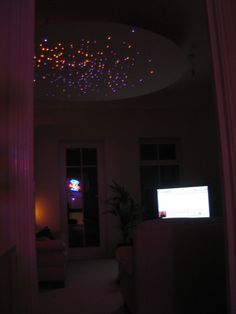A suspended fibre optic star disk is a strong focal point in this room.
