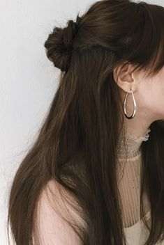 Teardrop shape silver hoops. Large oval hoop earrings by The Hexad Jewelry. #hoopearrings #silverhoops #earrings