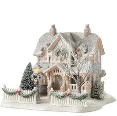 Department 56 always has beautiful collectibles. Great ideas for the trees, fence, and decorations for my own glitter house