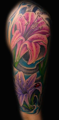 Lilies by Diego at Graceland Tattoo