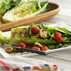 Grill Romaine lettuce to add a hint of smoky flavor. Serve with grilled vegetables to make a spectacular summer salad.