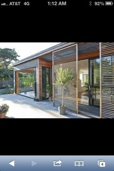 I like the wood slatted screens on this house