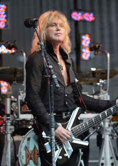 "Rick Savage Def Leppard | Rick Savage Rick Savage of Def Leppard performs during ""FOX & Friends ..."