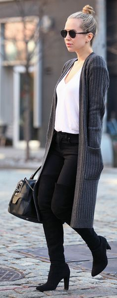 Over the knee boots look great with both simple and extravagant outfits. Helena Glazer shows us how to wear the trend with a plain tee and long cardigan.   Jeans/Cardigan/Bag: Rag & Bone, Boots: Stuart Weitzman.