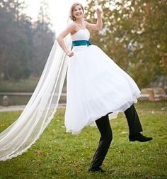 funny wedding picture of bride with groom's legs