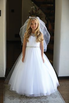 Beautiful First Communion Dress features intricate beadwork. This Long Length First Holy Communion dress offers a fully lined tulle skirt. Buy Catholic First Communion Dresses for Girls perfect for first communion or weddings. Designer First Communion Dresses, Girls First Communion Dresses, First Communion Veils, Holy Communion Dresses, Girls Pageant Dresses, Gowns For Girls, Party Dresses, Communion Hairstyles, Purple Bridesmaid Dresses
