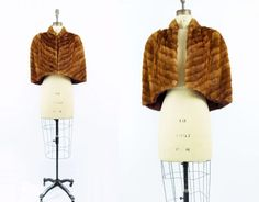 Lovely 1940s vintage mink fur stole capelet in rich tawny cinnamon, chevron patterned with neck-hugging stand collar, single fur clip neckline fasting, and deco print patterned chestnut lining. Nicely fitted, free size shoulder fits size small to large.  fits like: Small to Medium  bust: 48 @ bust level sweep @ hem: 58 length: 18 @ center front, center back: 20 cm measurements:  bust: 122 cm @ bust level sweep @ hem: 147 cm length: 46 cm center front, center back: 51 cm  condition: excellent…