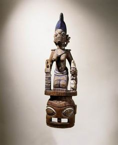 One of the best carvers and the suprastructure is not overloaden:    Helmet mask for the Epa masquerade  Yoruba people, Osi Ilorin, Nigeria  Early 20th century  Artist: Bambgose of Osi Ilorin (died: ca. 1920)  Wood and paint  H: 105; W: 30; D: 24 cm  Gift of Gaston de Havenon, New York, to American Friends of the Israel Museum
