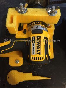Dewalt drill in 3D printed clamp for key cutting machine 24 hour locksmiths Brisbane with key