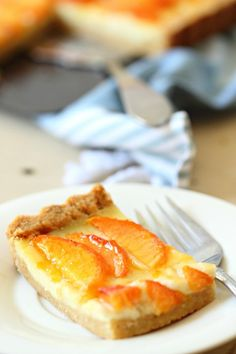 This is the best Peaches and Cream Custard Tart ever. The crust is like a shortbread cookie filled with rich pastry cream and topped with juicy peaches.