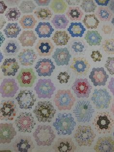 vintage quilt, grandmother's garden...I remember this pattern growing up. Our family quilts were usually made out of feed sacks.