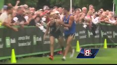 First place runner collapses 50m shy of finish line, helped across by second place runner