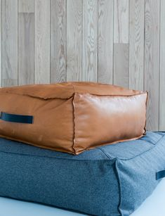 The Norman ottomans were designed for Project 82 back in 2015 by cm studio. Shown here in buttersoft Tan leather and charcoal felt. Leather Sofa, Tan Leather, Dynamic Architecture, Ottoman Design, Linen Sofa, Ottomans, Norman, Simple Designs, Modern Design