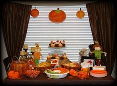 Pumpkin patch party theme. Pumpkin lanterns, scarecrows, pumpkin cookies and candies