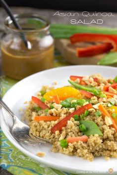 Asian Quinoa Salad - with snow peas, carrots, red pepper, mandarin oranges, chopped peanuts, green onions, ginger root, rice vinegar, sesame oil, honey, soy sauce, peanut butter, and hot sauce
