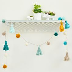 Make this easy DIY Savannah Tassel and Pom Pom Yarn Garland to coordinate with your decor #DIYDecor
