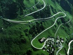 Oberalp Pass, Switzerland. Incredible road in the high Swiss mountains that's an important link between Central Switzerland and the Graubunden Oberland. The road is really popular for all drivers from Europe but it's only open during summer months. In winter this pass is closed for road traffic and the road itself is used as a ski slope, toboggan run and hiking trail!
