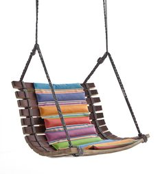 Angela Missoni designed a swinging chair formed by a playful string that connects the upcycled wooden staves of the casks, combined with colorful padding.