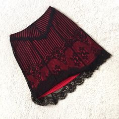 "Betsey Johnson Black Lace Overlay Skirt Feminine, darkly romantic black lace over a red underskirt. This is Betsey from the beloved 90's. Slight A-line shape. Beautifully patterned linear and floral lace. Invisible side zipper with hook/eye closure. Lace is 35% rayon; 35% nylon; 30% cotton. Lining is 100% polyester. Dry clean. *Size Small but fits more like an XS or size 2. Waist: 13"" flat across. Hip: 18"" flat across. Length: 21"" total (18.5"" plus 1.5"" lace hem.) EUC. Thanks for looking…"