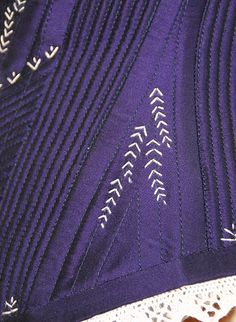 corded and flossed corset - detail - LOVE the leaf-like flossing