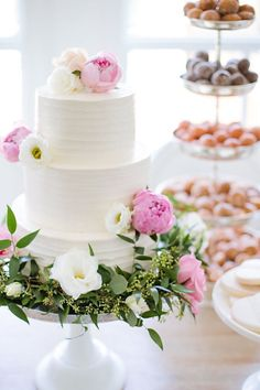 Fluffy white cake and macaron towers make perfect dessert ideas for a garden wedding party. Photo: Jamie Lauren Photography   Featured Dessert: Monika Hibbs