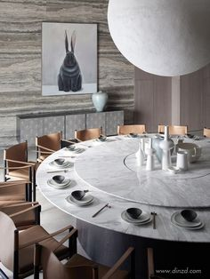 This marble top modern dining table would fit perfectly in any modern dining room project. Discover more statement dining tables here.