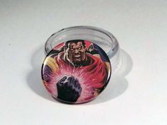 "Comic Book 1.5"" Button// Bishop, $1.00"