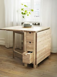 Quiet dinner for one, romantic dinner for two, room for a small dinner party, six convenient drawers for storage, and it tucks neatly away when not in use - The NORDEN gateleg table: one table, so many possibilities!