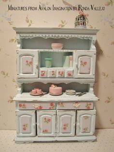 Miniature dollhouse shabby chic pastel blue kitchen hutch dresser with rose print on panels 1:12 scale.  via Etsy.